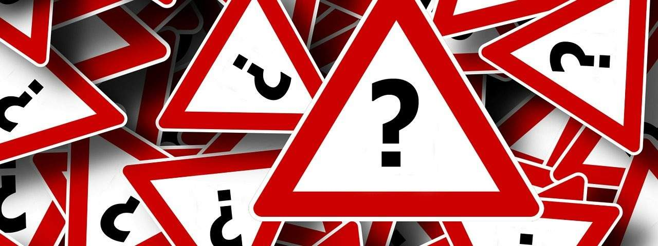 image of red triangle shaped tiles with question marks within