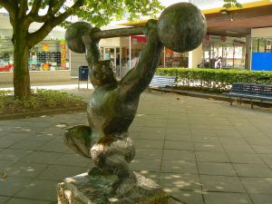 image of a bronze statue performing the snatch olympic lift