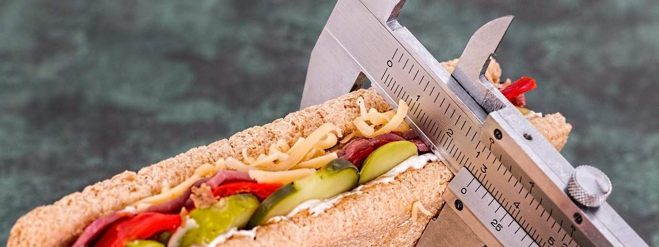 Image of calipers measuring a sandwich